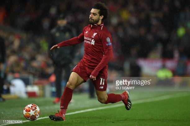 Liverpool's Egyptian midfielder Mohamed Salah chases the ball during the UEFA Champions League round of 16 first leg football match between Liverpool...