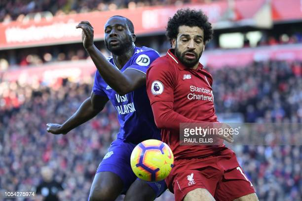 Liverpool's Egyptian midfielder Mohamed Salah competes with Cardiff City's Ivorian defender Sol Bamba during the English Premier League football...