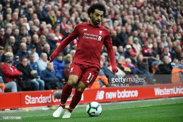 Liverpool's Egyptian midfielder Mohamed Salah controls the ball during the English Premier League football match between Liverpool and Southampton at...