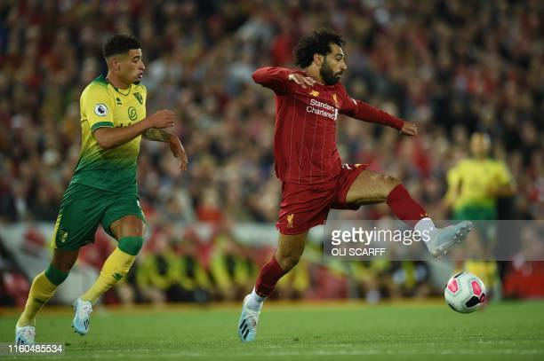 Liverpool's Egyptian midfielder Mohamed Salah controls the ball during the English Premier League football match between Liverpool and Norwich City...