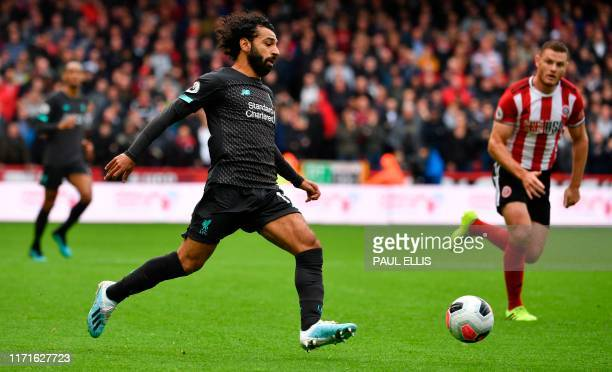Liverpool's Egyptian midfielder Mohamed Salah controls the ball during the English Premier League football match between Sheffield United and...