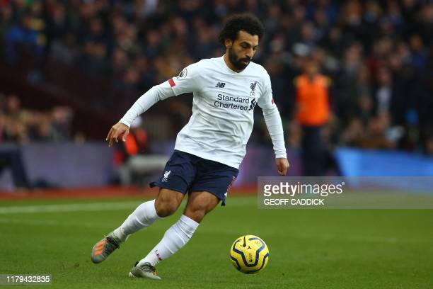 Liverpool's Egyptian midfielder Mohamed Salah controls the ball during the English Premier League football match between Aston Villa and Liverpool at...