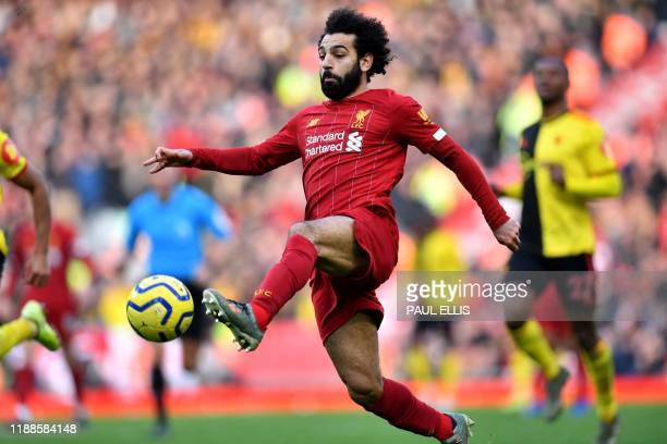 Liverpool's Egyptian midfielder Mohamed Salah controls the ball during the English Premier League football match between Liverpool and Watford at...