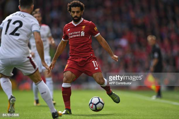 Liverpool's Egyptian midfielder Mohamed Salah controls the ball during the English Premier League football match between Liverpool and Burnley at...