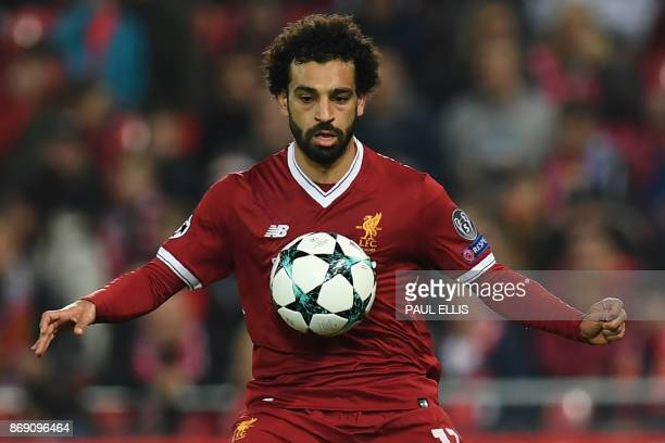 Liverpool's Egyptian midfielder Mohamed Salah controls the ball during the UEFA Champions League Group E football match between Liverpool and NK...
