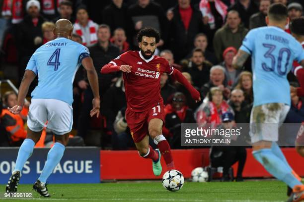 Liverpool's Egyptian midfielder Mohamed Salah controls the ball during the UEFA Champions League first leg quarterfinal football match between...