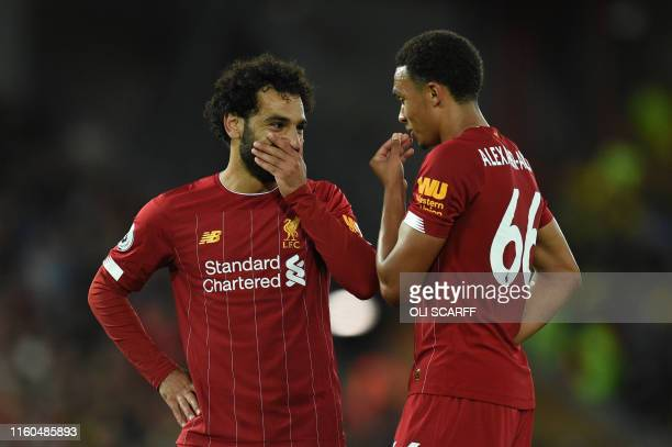 Liverpool's Egyptian midfielder Mohamed Salah discusses with Liverpool's English defender Trent AlexanderArnold during the English Premier League...