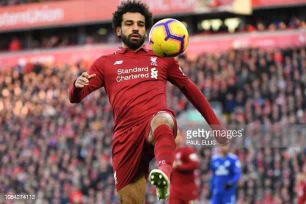 Liverpool's Egyptian midfielder Mohamed Salah eyes the ball during the English Premier League football match between Liverpool and Cardiff City at...