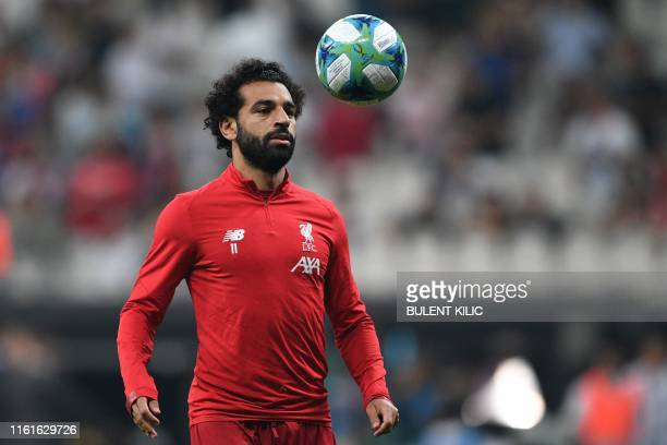 Liverpool's Egyptian midfielder Mohamed Salah eyes the ball during warm up ahead of the UEFA Super Cup 2019 football match between FC Liverpool and...