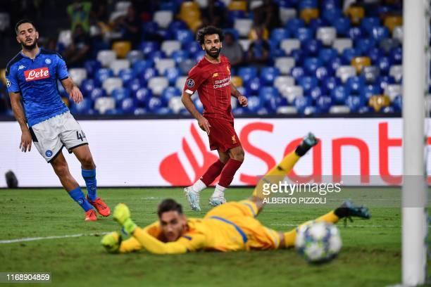 Liverpool's Egyptian midfielder Mohamed Salah fails to score past Napoli's Italian goalkeeper Alex Meret as Napoli's Greek defender Konstantinos...