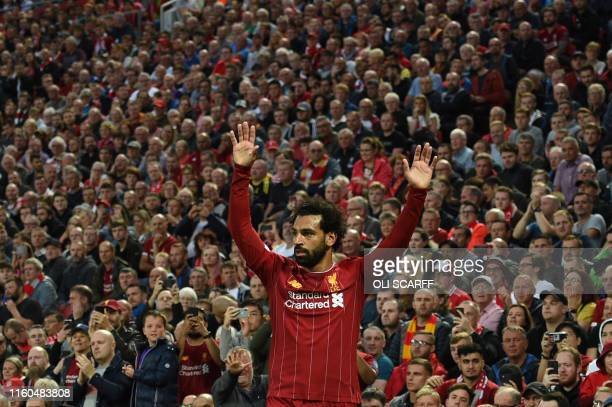 Liverpool's Egyptian midfielder Mohamed Salah gestures during the English Premier League football match between Liverpool and Norwich City at Anfield...