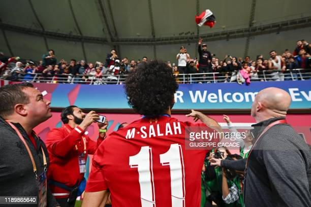 Liverpool's Egyptian midfielder Mohamed Salah greets the fans following the 2019 FIFA Club World Cup Final football match between England's Liverpool...