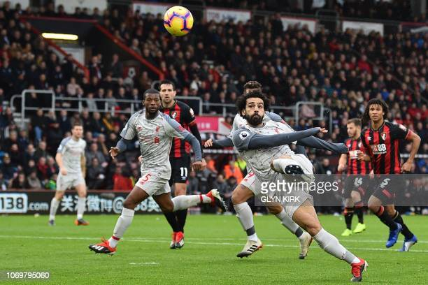 Liverpool's Egyptian midfielder Mohamed Salah has an unsuccessful shot during the English Premier League football match between Bournemouth and...