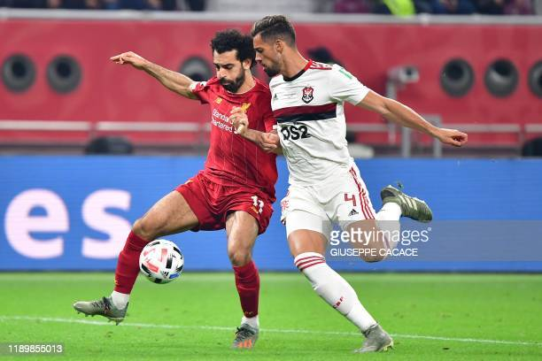 Liverpool's Egyptian midfielder Mohamed Salah is marked by Flamengos' defender Pablo Mari during the 2019 FIFA Club World Cup Final football match...