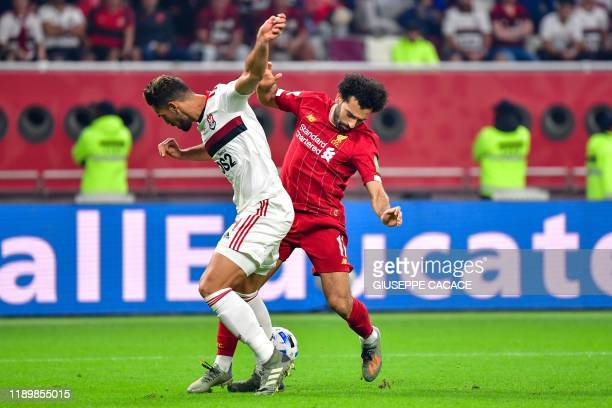 Liverpool's Egyptian midfielder Mohamed Salah is marked by Flamengo's defender Pablo Mari during the 2019 FIFA Club World Cup Final football match...