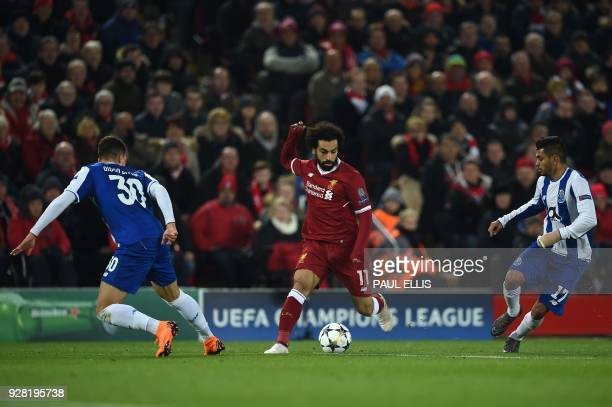 Liverpool's Egyptian midfielder Mohamed Salah is marked by Porto's Portuguese defender Diogo Dalot and Liverpool's Estonian defender Ragnar Klavan...