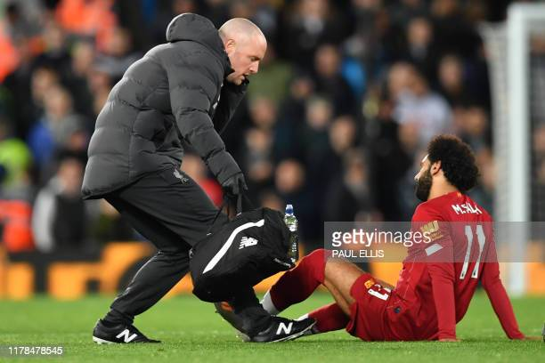 Liverpool's Egyptian midfielder Mohamed Salah is seen to by a medic during the English Premier League football match between Liverpool and Tottenham...