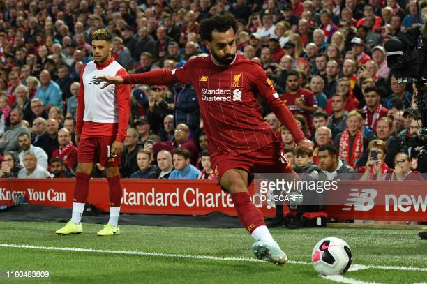 Liverpool's Egyptian midfielder Mohamed Salah kicks the ball during the English Premier League football match between Liverpool and Norwich City at...