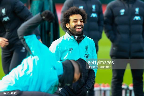 Liverpool's Egyptian midfielder Mohamed Salah laughs during a training session at Melwood in Liverpool north west England on February 17 on the eve...