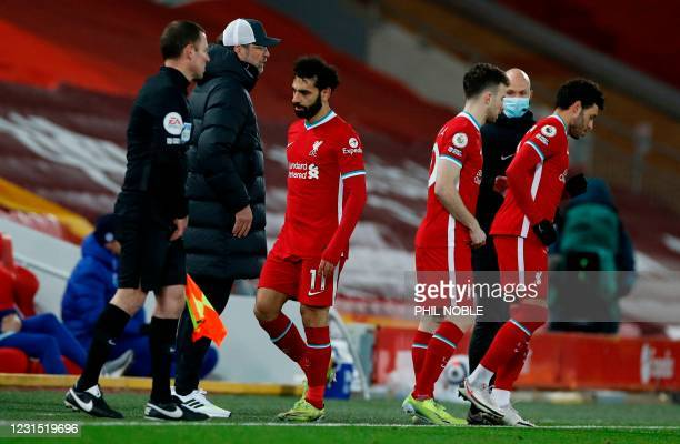 Liverpool's Egyptian midfielder Mohamed Salah leaves the pitch after being substituted during the English Premier League football match between...