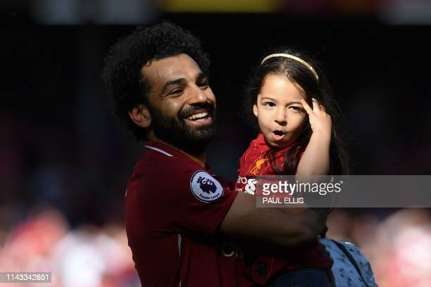 Liverpool's Egyptian midfielder Mohamed Salah lifts his fiveyearold daughter Makka at the end of the English Premier League football match between...
