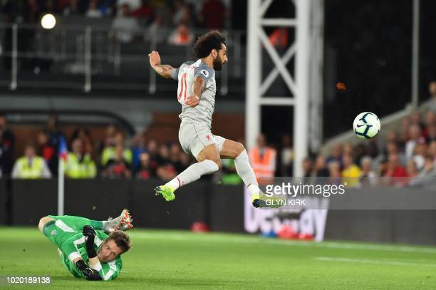 Liverpool's Egyptian midfielder Mohamed Salah lifts the ball over Crystal Palace's Welsh goalkeeper Wayne Hennessey but misses the target with his...
