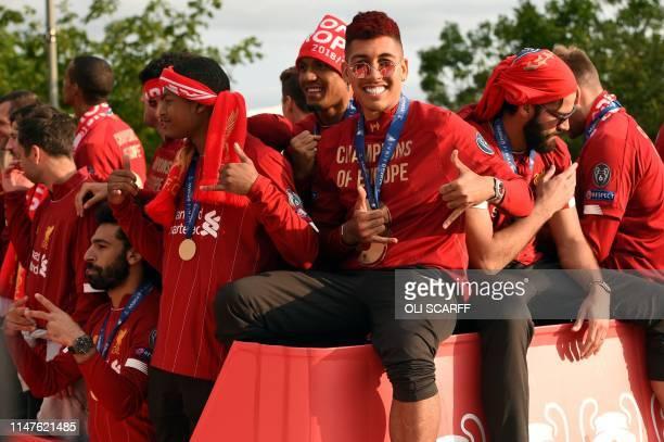 Liverpool's Egyptian midfielder Mohamed Salah Liverpool's Brazilian midfielder Roberto Firmino and Liverpool's Brazilian goalkeeper Alisson Becker...