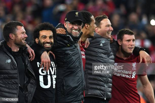 Liverpool's Egyptian midfielder Mohamed Salah , Liverpool's German manager Jurgen Klopp and Liverpool's Dutch defender Virgil van Dijk celebrate...