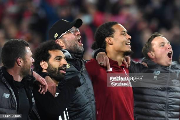 TOPSHOT Liverpool's Egyptian midfielder Mohamed Salah Liverpool's German manager Jurgen Klopp and Liverpool's Dutch defender Virgil van Dijk...
