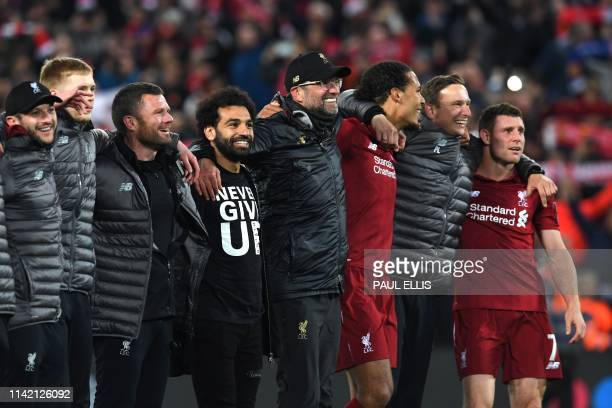 Liverpool's Egyptian midfielder Mohamed Salah Liverpool's German manager Jurgen Klopp and Liverpool's Dutch defender Virgil van Dijk celebrate after...