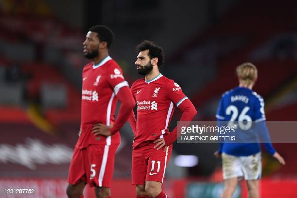Liverpool's Egyptian midfielder Mohamed Salah looks on during the English Premier League football match between Liverpool and Everton at Anfield in...