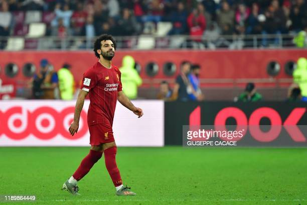 Liverpool's Egyptian midfielder Mohamed Salah makes his way to the bench during the 2019 FIFA Club World Cup Final football match between England's...