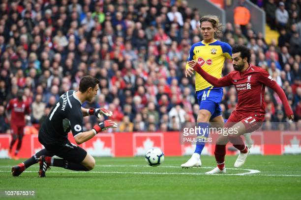 Liverpool's Egyptian midfielder Mohamed Salah misses a chance at goal during the English Premier League football match between Liverpool and...