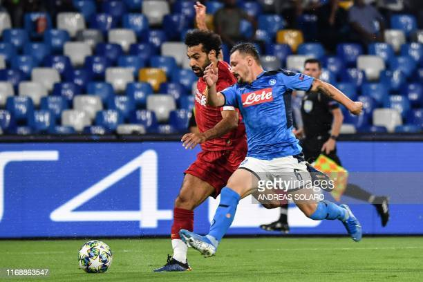 Liverpool's Egyptian midfielder Mohamed Salah outruns Napoli's Portuguese defender Mario Rui during the UEFA Champions League Group E football match...