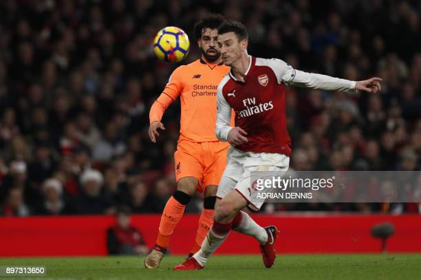 Liverpool's Egyptian midfielder Mohamed Salah pass ricochets off Arsenal's French defender Laurent Koscielny to create a chance for Liverpool's...