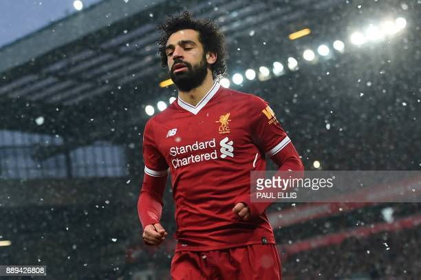 Liverpool's Egyptian midfielder Mohamed Salah plays during the English Premier League football match between Liverpool and Everton at Anfield in...