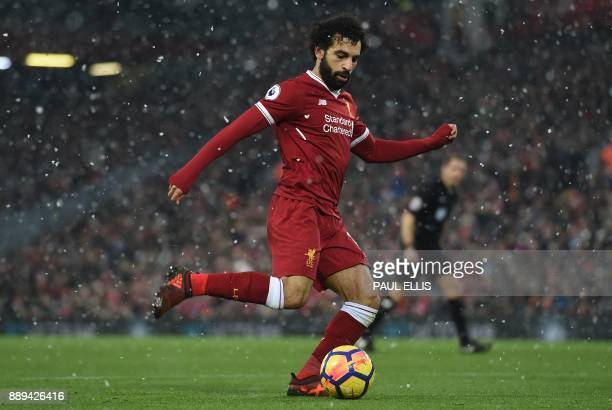 Liverpool's Egyptian midfielder Mohamed Salah plays the ball during the English Premier League football match between Liverpool and Everton at...