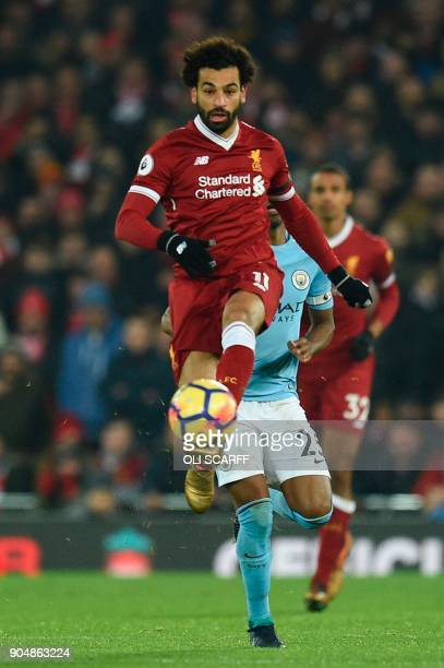 Liverpool's Egyptian midfielder Mohamed Salah plays the ball during the English Premier League football match between Liverpool and Manchester City...