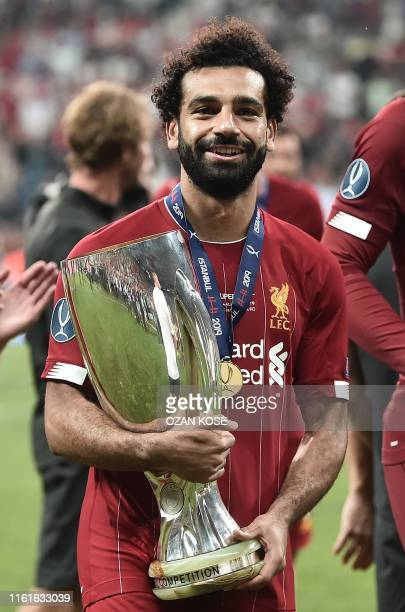 Liverpool's Egyptian midfielder Mohamed Salah poses with the trophey after Liverpool won the UEFA Super Cup 2019 football match between FC Liverpool...