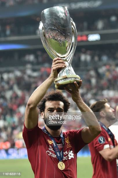 Liverpool's Egyptian midfielder Mohamed Salah poses with the trophy after winning the UEFA Super Cup 2019 football match between FC Liverpool and FC...