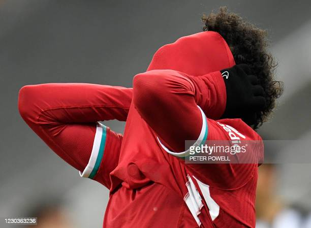 Liverpool's Egyptian midfielder Mohamed Salah reacts after failing to score during the English Premier League football match between Newcastle United...