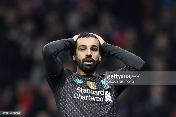 Liverpool's Egyptian midfielder Mohamed Salah reacts after missing a goal opportunity during the UEFA Champions League round of 16 first leg football...