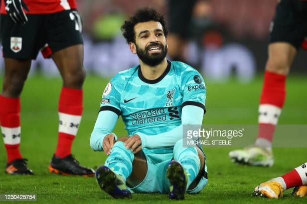 Liverpool's Egyptian midfielder Mohamed Salah reacts after missing a chance during the English Premier League football match between Southampton and...