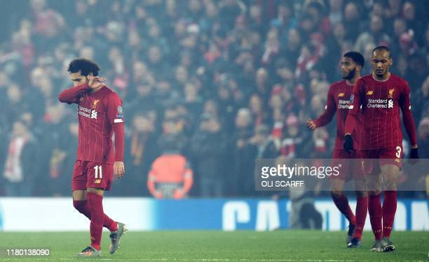 Liverpool's Egyptian midfielder Mohamed Salah reacts after RC Genk's Tanzanian forward Mbwana Ally Samatta equalised during the UEFA Champions League...