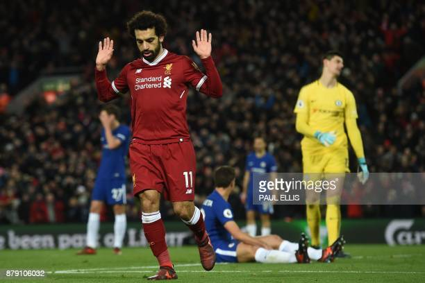 Liverpool's Egyptian midfielder Mohamed Salah reacts after scoring the opening goal of the English Premier League football match between Liverpool...