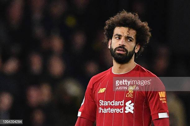 Liverpool's Egyptian midfielder Mohamed Salah reacts after Watford's Senegalese midfielder Ismaila Sarr scores his team's second goal during the...