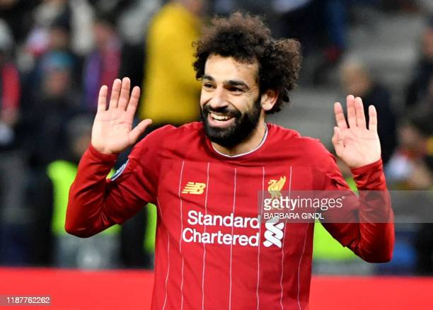 Liverpool's Egyptian midfielder Mohamed Salah reacts at the end of the UEFA Champions League Group E football match between RB Salzburg and Liverpool...