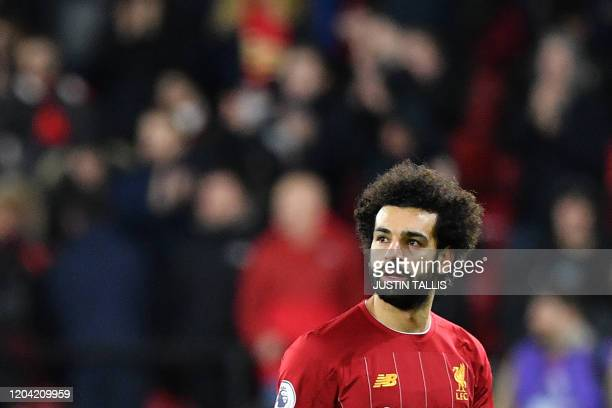 Liverpool's Egyptian midfielder Mohamed Salah reacts at the final whistle during the English Premier League football match between Watford and...