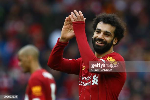Liverpool's Egyptian midfielder Mohamed Salah reacts at the final whistle during the English Premier League football match between Liverpool and...
