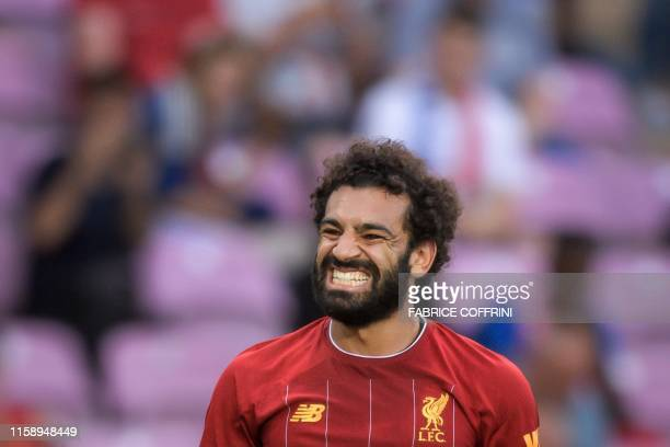 Liverpool's Egyptian midfielder Mohamed Salah reacts during a pre-season international friendly football match between Liverpool and Lyon on July 31,...